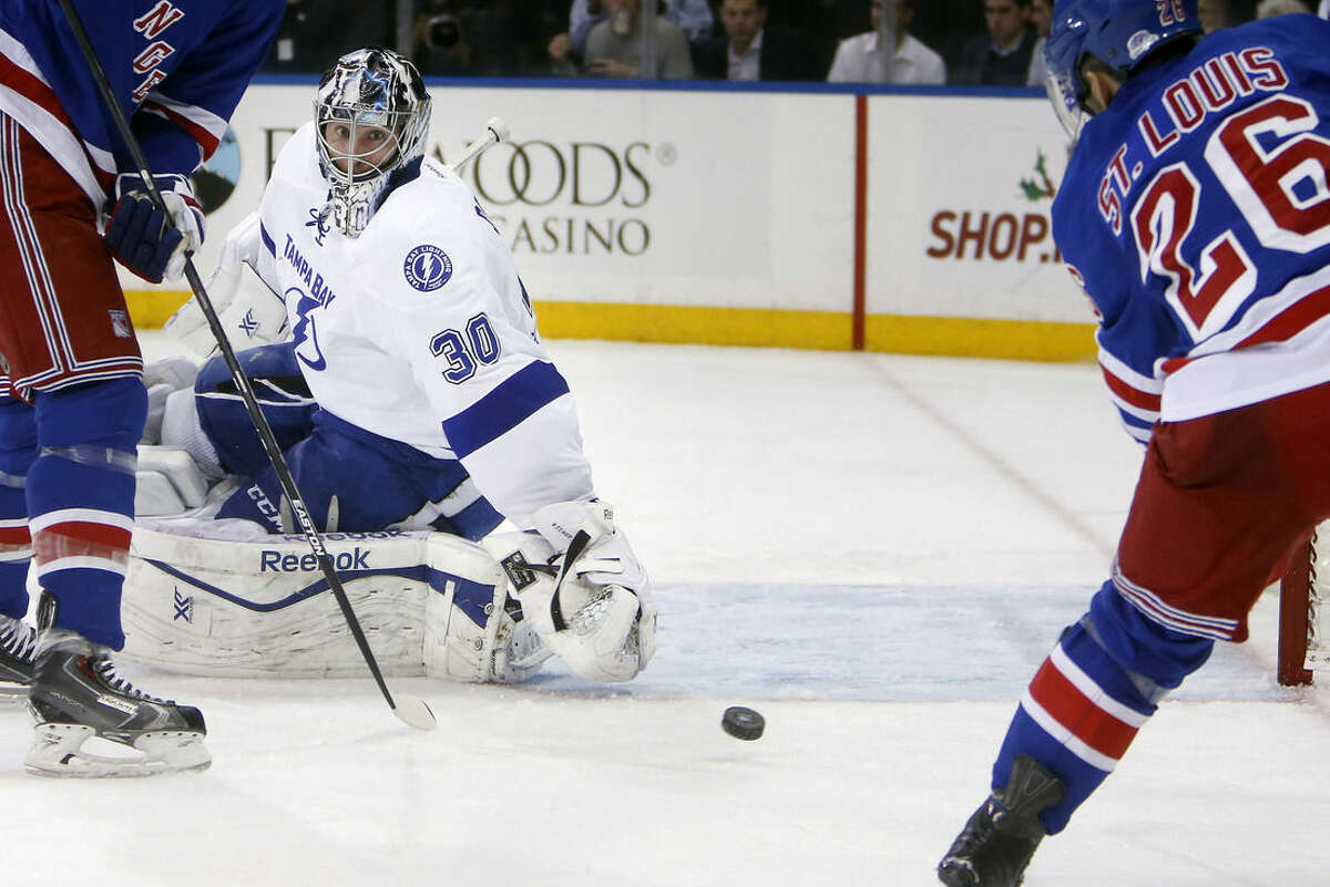 Tampa Bay Lightning goalie Ben Bishop (30) watches as a shot from New York Rangers' Martin St. Louis (26) goes into the net during the second period of an NHL hockey game Monday, Dec. 1, 2014, in New York. (AP Photo/Jason DeCrow)