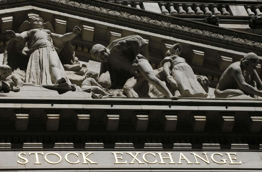 FILE - This July 15, 2013 file photo shows the New York Stock Exchange in New York. The stock market is opening lower Monday, Dec. 1, 2014, following more signs of weakness in China's economy and disappointing U.S. retail sales over Thanksgiving weekend. (AP Photo/Mark Lennihan, File)