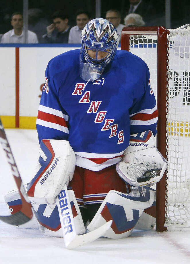 New York Rangers goalie Henrik Lundqvist (30), of Sweden, makes a save against the Tampa Bay Lightning during the first period of an NHL hockey game Monday, Dec. 1, 2014, in New York. (AP Photo/Jason DeCrow)