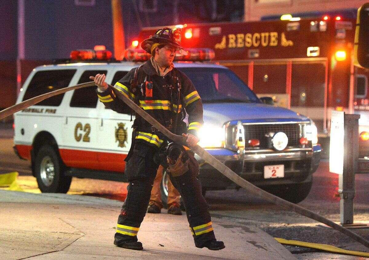 Hour Photo/Alex von Kleydorff Norwalk Firefighters respond to a fire at B.J. Ryan's on Main St. Monday evening in the kitchen of the restaurant