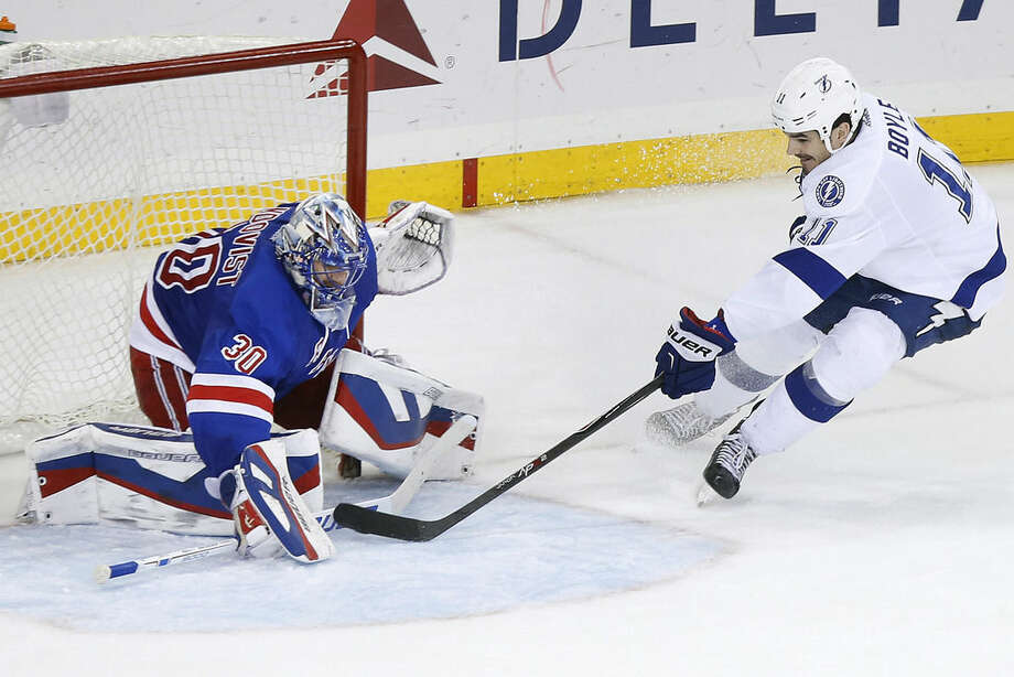 New York Rangers goalie Henrik Lundqvist (30), of Sweden, saves a shot by Tampa Bay Lightning's Brian Boyle (11) during the third period of an NHL hockey game Monday, Dec. 1, 2014, in New York. Tampa Bay beat New York 6-3. (AP Photo/Jason DeCrow)