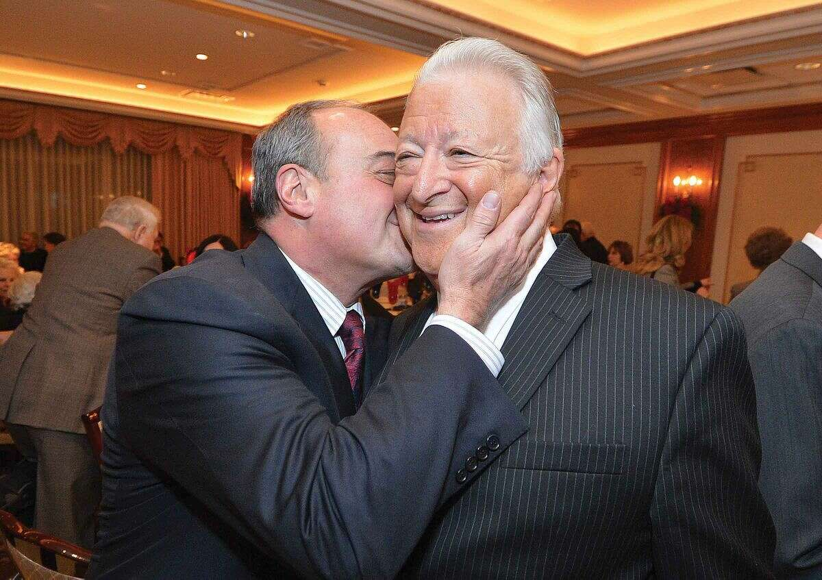 Hour Photo/Alex von Kleydorff Former Norwalk Mayor Richard Moccia gets a hug and a kiss from friend and House Minority Leader Larry Cafero during a tribute evening in honor of Dick Moccia at The Norwalk Inn and Conference Center