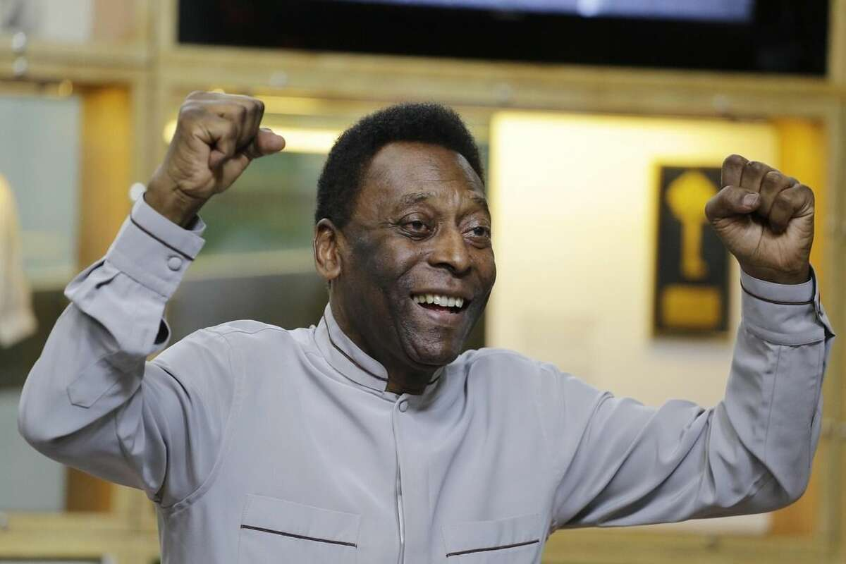 FILE - In this June 15, 2014 file photo, soccer great Pele poses for photos during the inauguration of the Pele Museum, in Santos, Brazil. Soccer great Pele isn't showing signs of the urinary tract infection that prompted his hospitalization and doctors said they will suspend kidney treatment. The Albert Einstein hospital in Sao Paulo said Saturday, Nov. 29, 2014, that the 74-year-old Pele remains in an intensive care unit, but his condition was constantly improving. (AP Photo/Nelson Antoine, File)