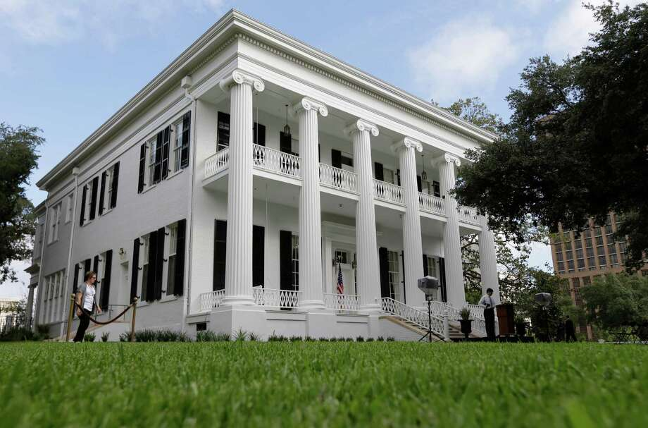 The restored Texas Governor's Mansion is seen Wednesday, July 18, 2012, in Austin, Texas. After four years and a $25 million restoration project, the historic Texas Governor's Mansion that was nearly destroyed by fire is complete. (AP Photo/Eric Gay) Photo: Eric Gay, STF / AP