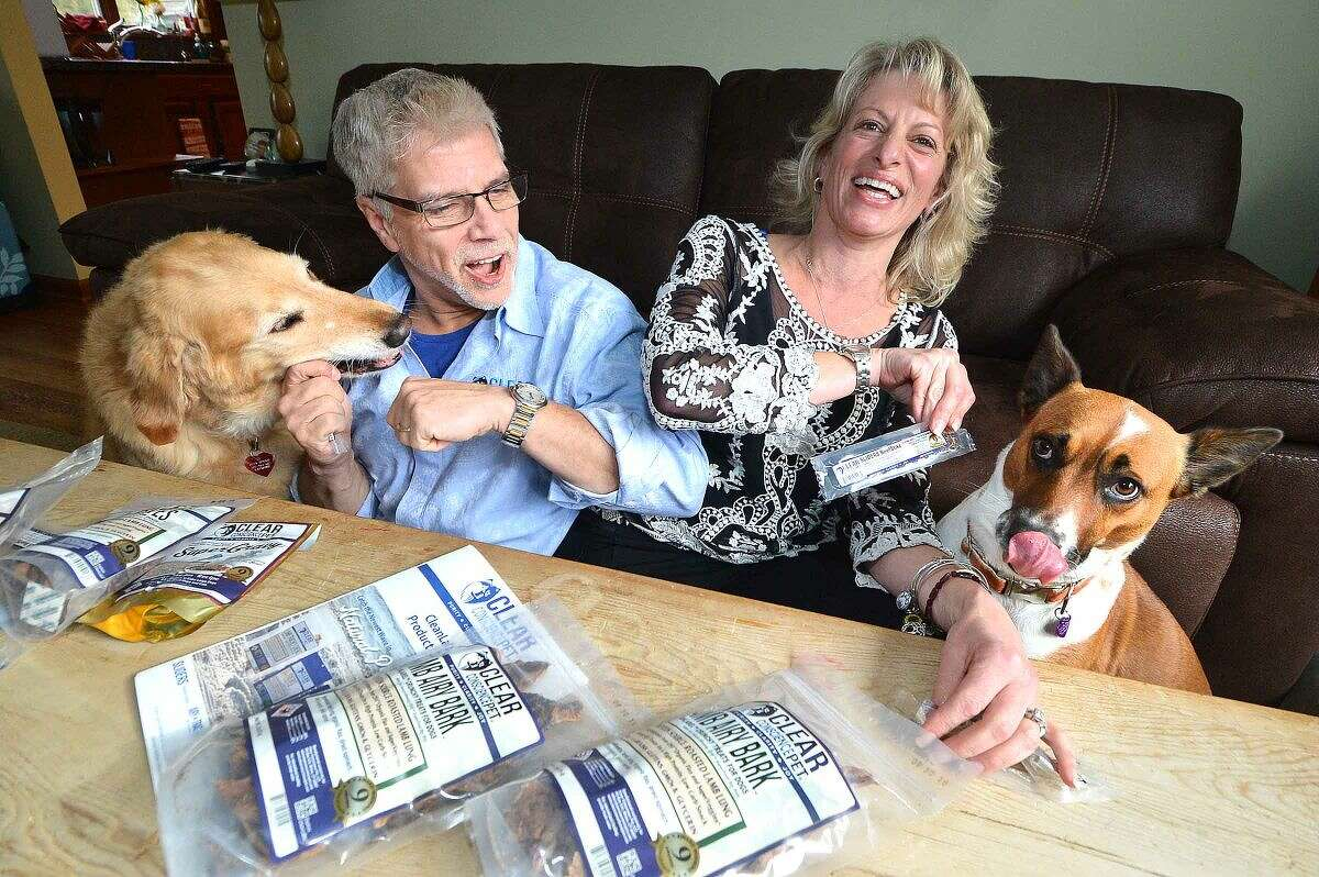 Wiltonians Anthony and Amanda Bennie created Clear Conscience Pet Co. and their dogs, Golden Ozzy and Potcake Taylor Bay, love the all-natural beef slider treats.