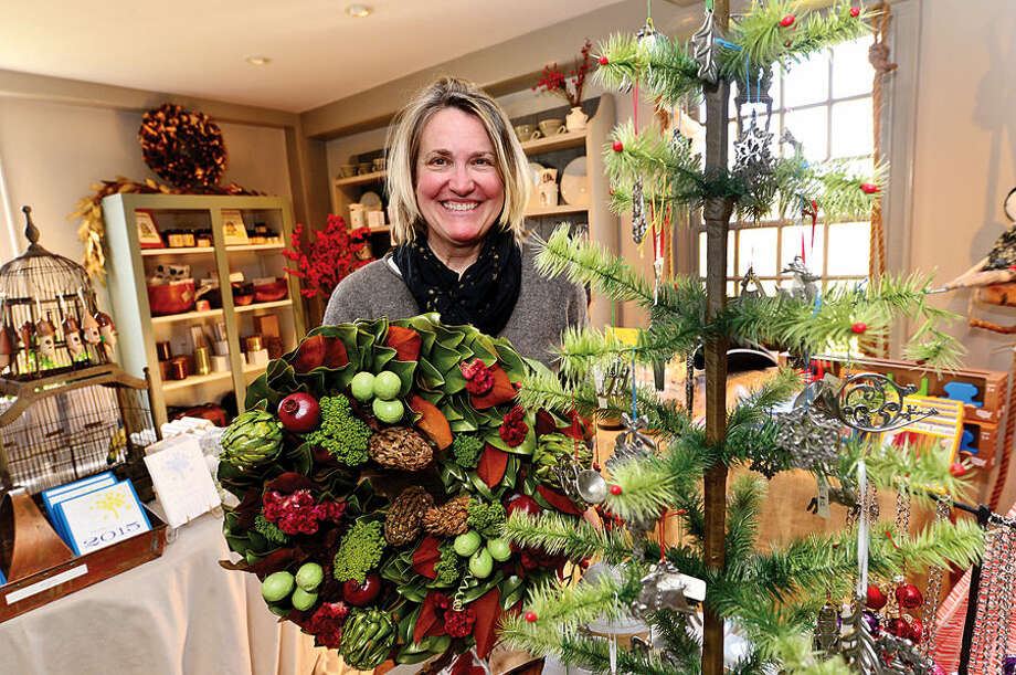 Wilton Historical Society Executive Director Leslie Nolan prepares items for the society's annual Holiday Trunk Show scheduled for Dec. 11-12.
