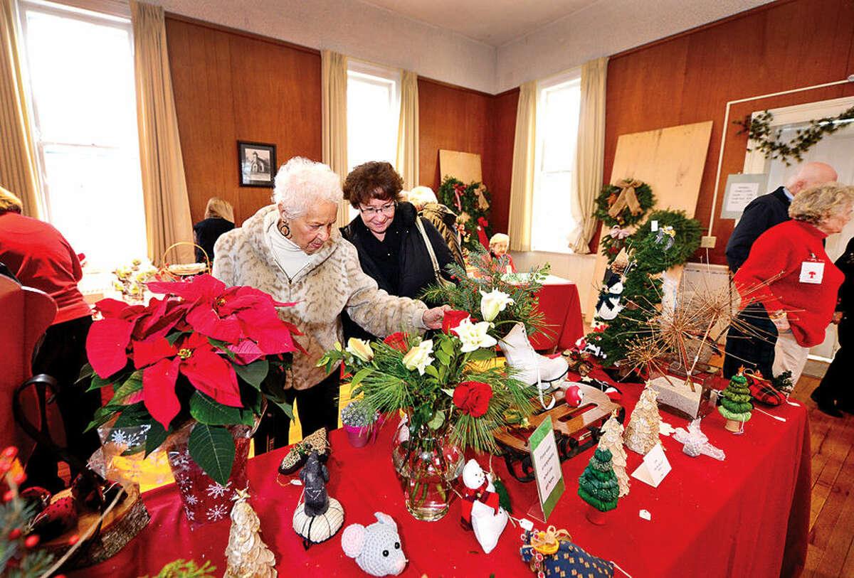 Hour photo / Erik Trautmann Virginia Finnie and her daughter Lori Viselli look for handmade items at Norwalk Garden Club's annual Christmas craft fair at Cranbury Chapel Saturday.