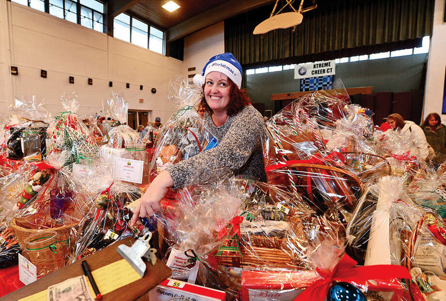 Hour photo / Erik Trautmann Shelly Grace sells tickets for the silent auction during the St. Ladislaus annual Christmas fair Saturday.