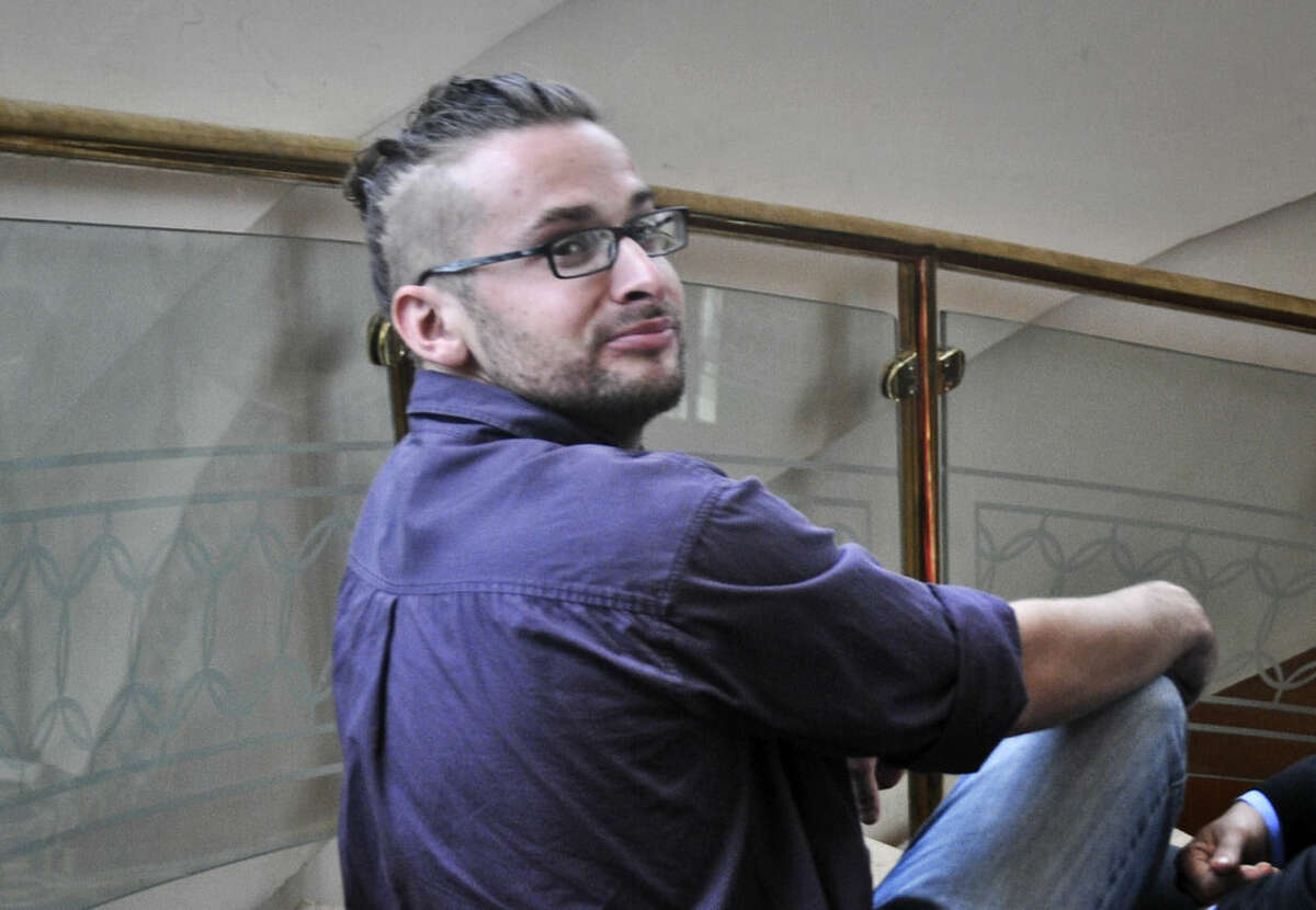 In this Sunday, July, 7, 2013, Luke Somers, 33, an American photojournalist who was kidnapped over a year ago by al-Qaida poses for a picture in Sanaa, Yemen. Somers and a South African teacher held by al-Qaida militants in Yemen were killed Saturday, Dec. 6, 2014 during a U.S.-led rescue attempt, a raid President Barack Obama said he ordered over an