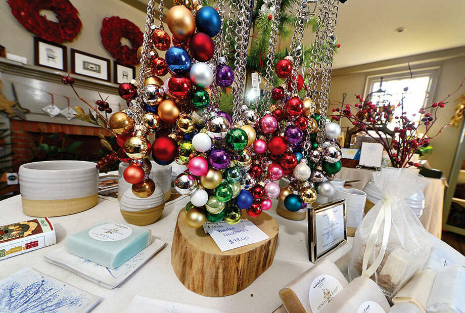 The Wilton Historical Society prepares items for its annual Holiday Trunk Show scheduled for Dec. 11-12.