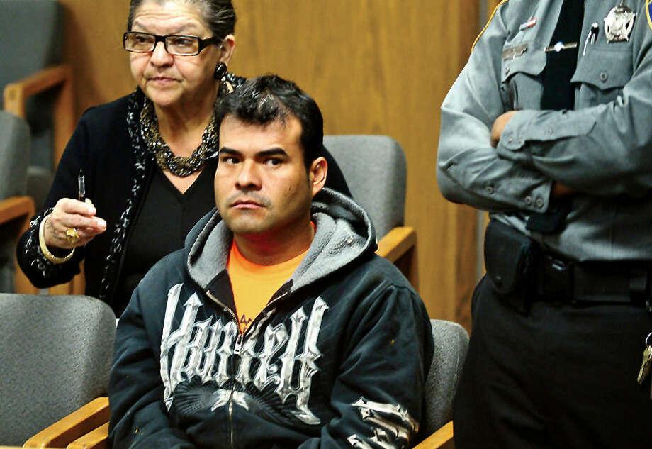 Hour photo / Erik Trautmann Suspect in the stabbing death of taxi driver Arcos Garcia awaits his arraignment in Norwalk Superior Court.