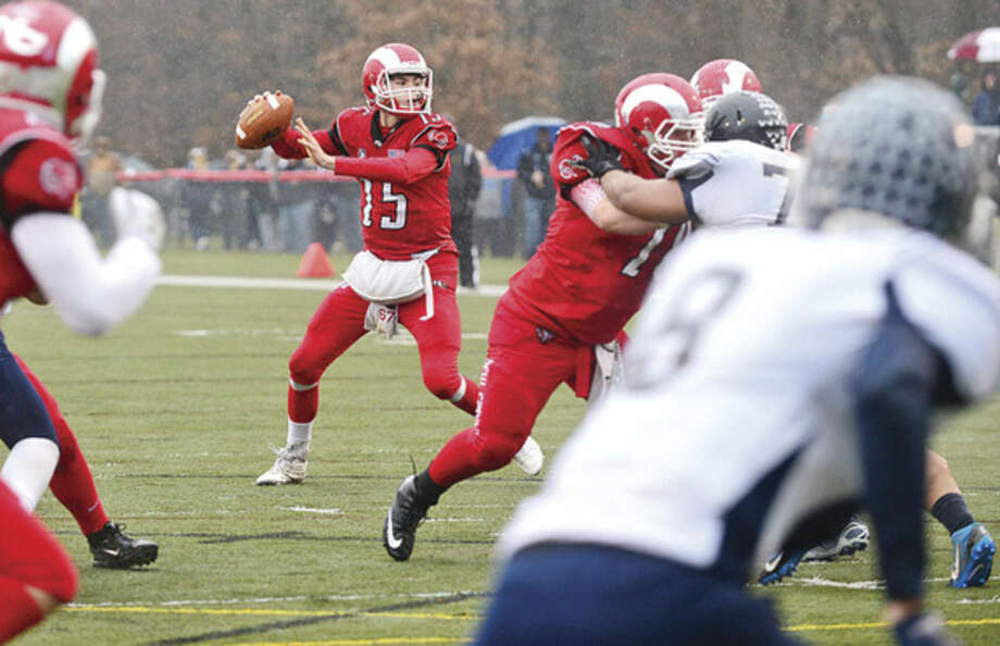 Hour photo / Erik Trautmann # of New Canaan runs through the Westfield defense during their state playoff game Saturday.