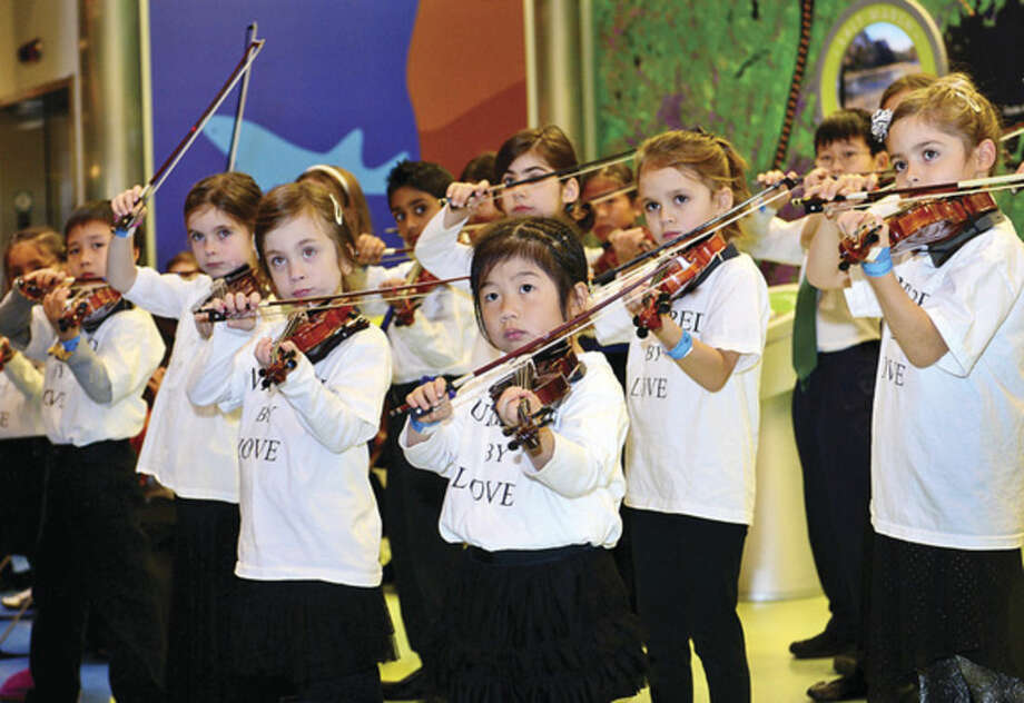 Hour photo/Erik TrautmannAs part of the December music series at the Maritime Aquarium, students of the Talent Education Suzuki School (TESS) Mixed Ensemble perform classical selections, including pieces by Bach, Giuliani and Paganini.