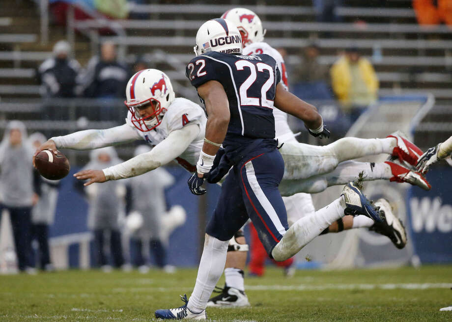 Southern Methodist quarterback Matt Davis (4) dives for a touchdown in front of Connecticut safety Andrew Adams (22) during the third quarter of an NCAA college football game in East Hartford, Conn., Saturday, Dec. 6, 2014. SMU won 27-20. (AP Photo/Michael Dwyer)