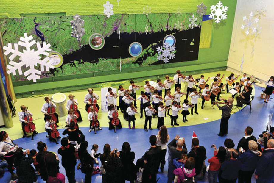Hour photo/Erik TrautmannAs part of the December music series at the Maritime Aquarium students of the Talent Education Suzuki School (TESS) Mixed Ensemble perform classical selections, including pieces by Bach, Giuliani and Paganini.
