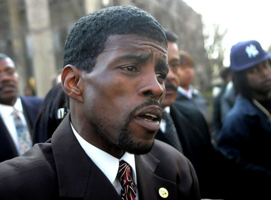 FILE - In this Feb. 2, 2006 photo, former state Sen. Ernest Newton leaves U.S. District Court in Bridgeport, Conn., after he was sentenced to five years in prison and three years probation for accepting a $5,000 bribe and other charges. Newton is running for his old 23rd Senate District seat two years after he got out of prison. Newton won the endorsement district Democrats in a three-way race in the Aug. 14, 2012, primary. (AP Photo/Bob Child, File) / AP2006