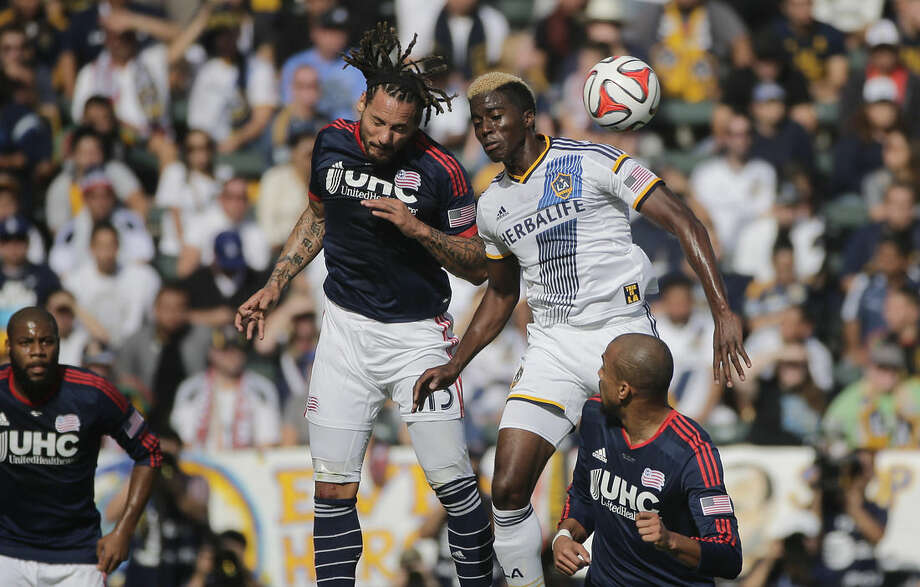 Los Angeles Galaxy's Gyasi Zardes, top right, and New England Revolution's Jermaine Jones, of Germany, head the ball during the first half of the MLS Cup championship soccer match Sunday, Dec. 7, 2014, in Carson, Calif. (AP Photo/Jae C. Hong)