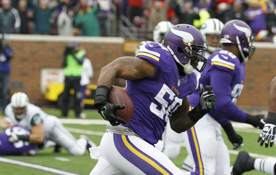 Minnesota Vikings outside linebacker Gerald Hodges (50) runs up field while returning an interception 27-yards for a touchdown in the first half of an NFL football game against the New York Jets, Sunday, Dec. 7, 2014, in Minneapolis. (AP Photo/Ann Heisenfelt)