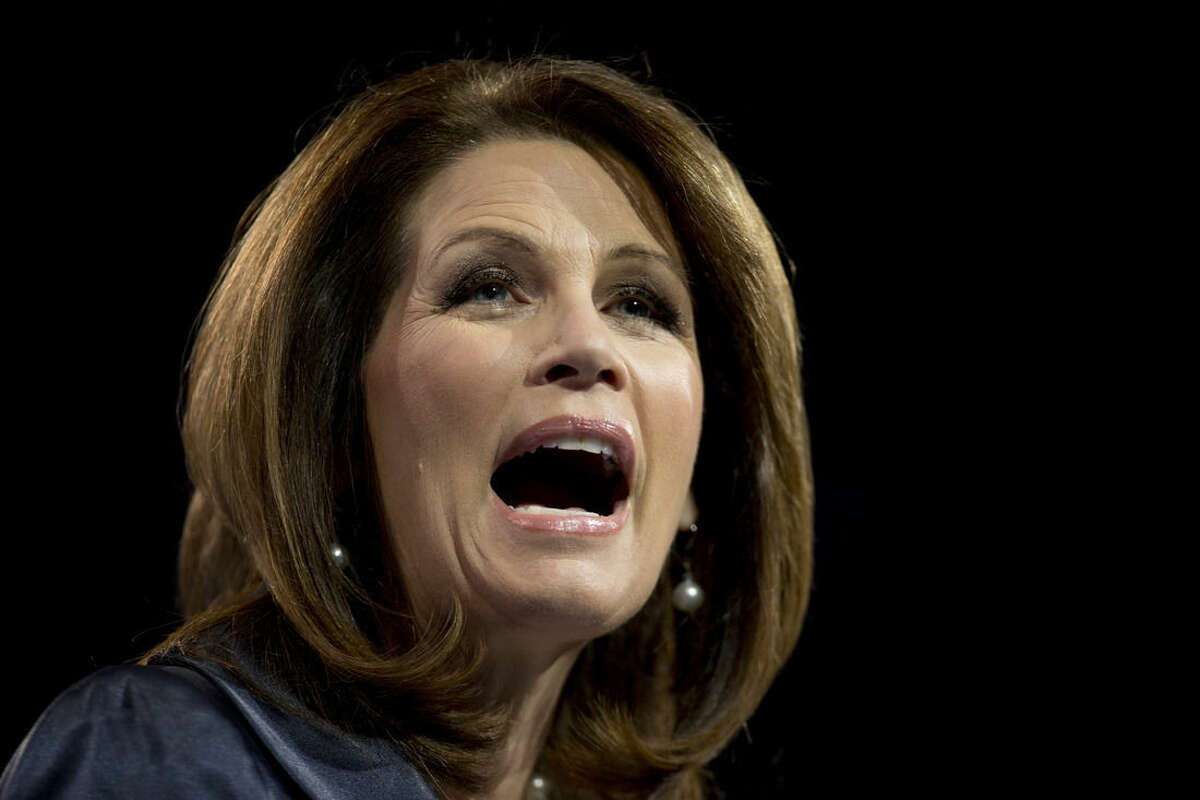 FILE - In this March 16, 2013 file photo, Rep. Michelle Bachmann, R- Minn., speaks at the 40th annual Conservative Political Action Conference in National Harbor, Md. An audacious conservative with a telling Minnesota twang, Rep. Michele Bachmann stood out from the moment she entered in Congress in 2006. The Republican is now ending a turbulent career marked by fights with the left and her own party, as well as a fast-rising and then fast-fading presidential campaign. (AP Photo/Carolyn Kaster)