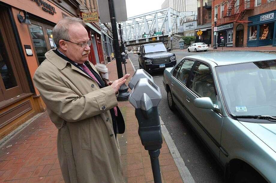 Hour Photo/Alex von Kleydorff Motorsits feed the meter along Washinton St In SoNo