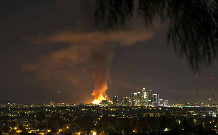 AP Photo/Nancy YuilleThis photo provided by Nancy Yuille shows a massive fire engulfing an apartment building construction site near downtown Los Angeles on Monday, Dec. 8. Crews battled two large fires in Los Angeles early Monday, including a massive one downtown that closed portions of two major freeways and blanketed the area in ash and heavy smoke.