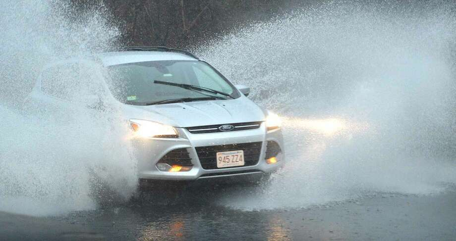 Hour Photo/Alex von Kleydorff Motorists encounter deep water along Van Buren Ave. on Tuesday
