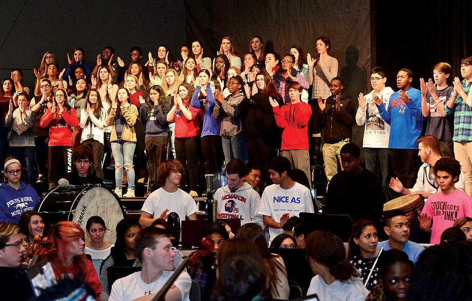 Hour photo / Erik Trautmann Brien McMahon High School choir, orchestra and band rehearse for its annual Poinsettia winter concert.