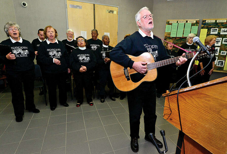 "Hour photo / Erik Trautmann Guitarist Bruce Taylor leads the Serendipity Chorale in the song ""We Shall Overcome"" during the 23rd annual International Human Rights Day at Norwalk City Hall."