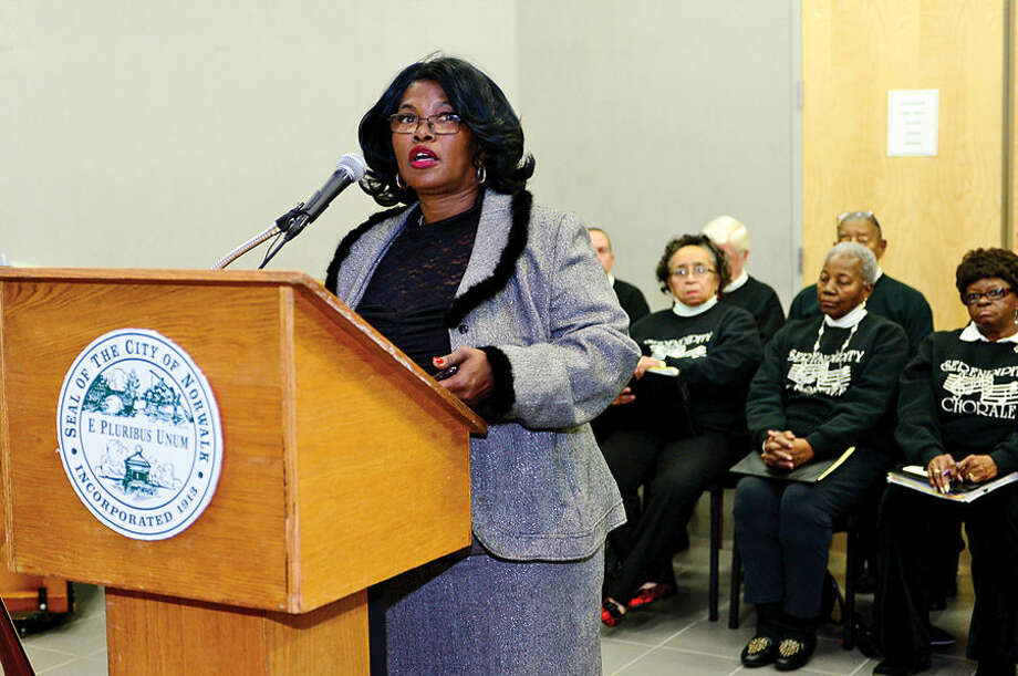 Hour photo / Erik Trautmann Chairpaerson for the HRC Subcommittee on International Human Rights Day, Daisy Franklin, introduces the jeynote speaker during the 23rd annual International Human Rights Day at Norwalk City Hall.