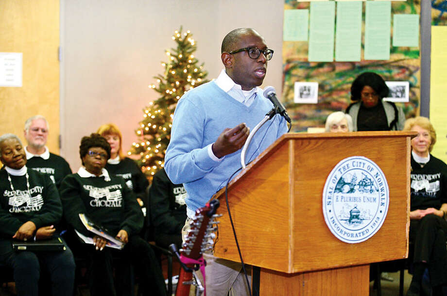 Hour photo / Erik Trautmann Norwalk NAACP president Darnell Crosland speaks to those gathered at the 23rd annual International Human Rights Day at Norwalk City Hall.