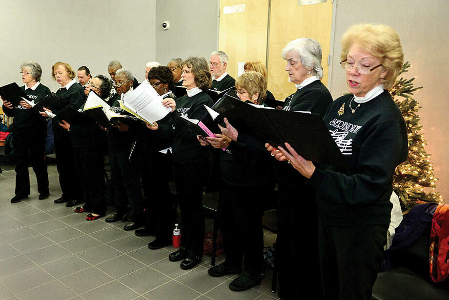 "Hour photo / Erik Trautmann The Serendipity Chorale sings "" Lift Every Voice and Sing"" during the 23rd annual International Human Rights Day at Norwalk City Hall."