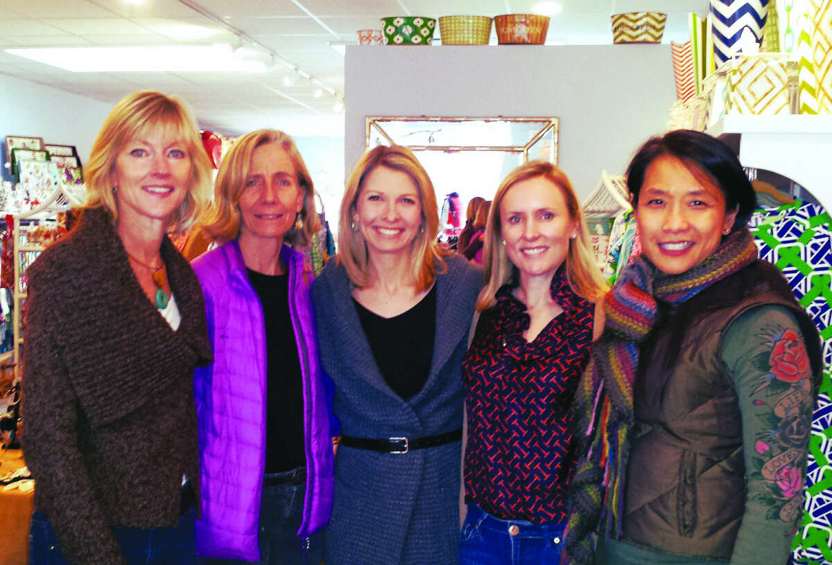 Contributed photo YWCA Darien/Norwalk Parent Awareness committee members Diane Barston (Parent Awareness coordinator), Alicia Sillars (Darien Youth Commission), Jeanne Yurman, Christina Passaretti and Pam Ha-Stevenson (Parent Awareness coordinator) kickoff the benefit boutique hosted by retailer Everything is Rosey in Darien on Dec. 3.