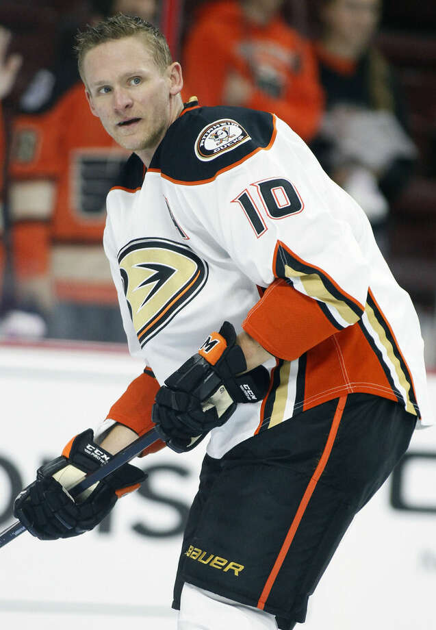 FILE - In this Tuesday, Oct. 14, 2014 file photo, Anaheim Ducks' Corey Perry looks during warm ups before an NHL hockey game against the Philadelphia Flyers in Philadelphia. Multiple players on multiple teams across the country have come down with the mumps that has spread from coast to coast, Thursday, Dec. 11, 2014.(AP Photo/Tom Mihalek, File)