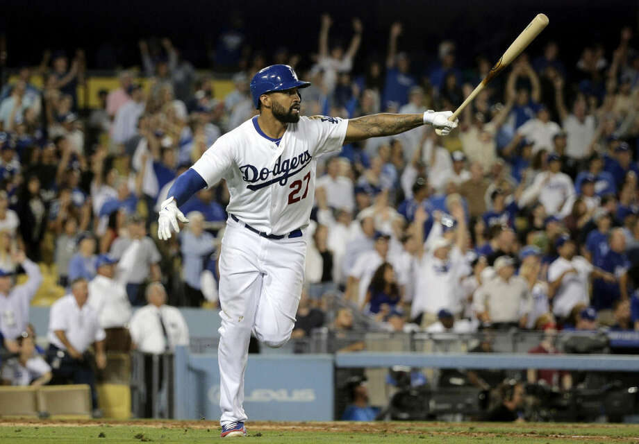 FILE - In this July 29, 2014, file photo, Los Angeles Dodgers' Matt Kemp watches the flight of his second two-run home run, during the seventh inning of a baseball game against the Atlanta Braves in Los Angeles. A person with knowledge of the situation says the San Diego Padres have a deal in place to acquire outfielder Matt Kemp and catcher Tim Federowicz from the division rival Los Angeles Dodgers for catcher Yasmani Grandal and two pitchers. The person spoke on condition of anonymity Thursday, Dec. 11, 2014, because the deal hadn't been announced by either team. (AP Photo/Jae C. Hong, File)