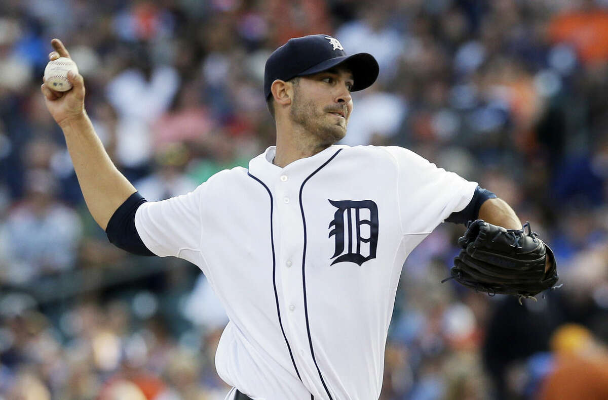 FILE - In this Aug. 15, 2014, file photo, Detroit Tigers starting pitcher Rick Porcello throws during the first inning of a baseball game against the Seattle Mariners in Detroit. The Boston Red Sox have agreed to trade outfielder Yoenis Cespedes to the Detroit Tigers for pitcher Rick Porcello, according to a person familiar with the negotiations. Right-handed pitching prospect Alex Wilson also will go to Detroit as part of the trade, the person said Thursday, Dec. 11, 2014, speaking on condition of anonymity because no announcement had been made. (AP Photo/Carlos Osorio, File)