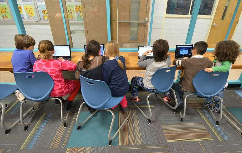 Hour Photo/Alex von Kleydorff Kids take over the laptops at Silvermine School's new Learning Commons
