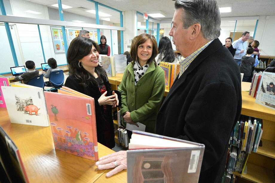 Hour Photo/Alex von Kleydorff PTO President Lorena Davison talks with two of the projects sponsors Beth and Bob Heslin, Owners of Jan-Pro Cleaners, in the new Learning Commons