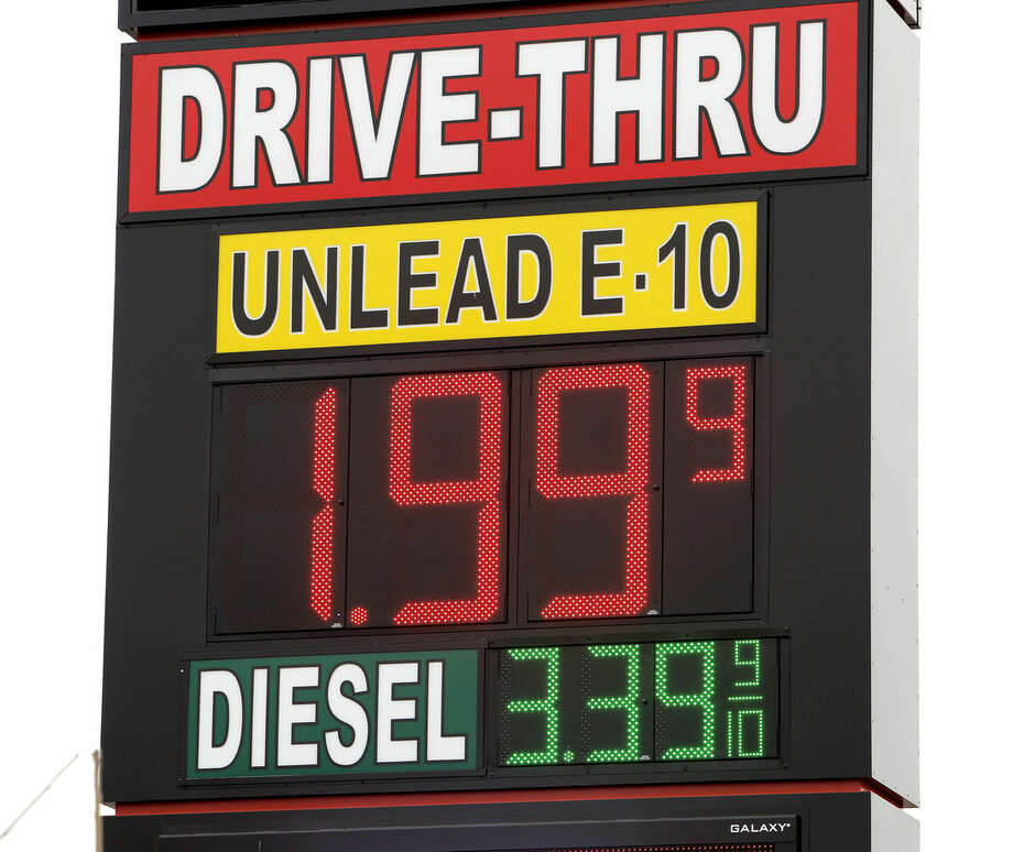 FILE - In this Dec. 3, 2014 file photo a sign displays the price for E-10 gasoline for $1.99 at the OnCue convenience store and gas station in Oklahoma City. With oil prices now around a five-year low, budget officials in about a half-dozen states already have begun paring back projections for a continued gusher of revenues and more could be necessary if oil prices stay at lower levels. (AP Photo/The Oklahoman, Paul B. Southerland, File) LOCAL STATIONS OUT (KFOR, KOCO, KWTV, KOKH, KAUT OUT); LOCAL WEBSITES OUT; LOCAL PRINT OUT (EDMOND SUN OUT, OKLAHOMA GAZETTE OUT) TABLOIDS OUT