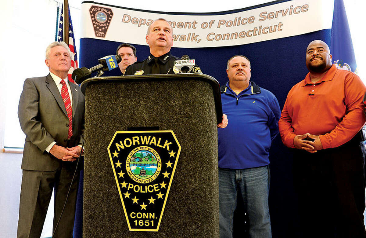 Hour photo / Erik Trautmann Norwalk police chief Thomas Kulhawik annouce the capture of cabbie stabbing suspect Ramiro Arcos-Garcia during a press conference Friday with Norwalk Mayor Harry Rilling, Deputy Chief David Wrinn, and detectives Lt Thomas Mattera and Sargent Lee Young.
