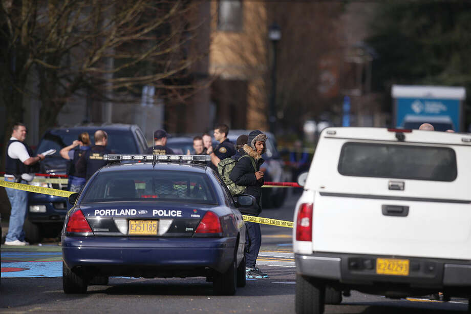 The scene in North Portland where a shooting occurred near Rosemary Anderson High School on Dec. 12, 2014. A shooter wounded two boys and a girl outside the high school Friday in what may be a gang-related attack, police said. (AP Photo/The Register-Guard, Bruce Ely)