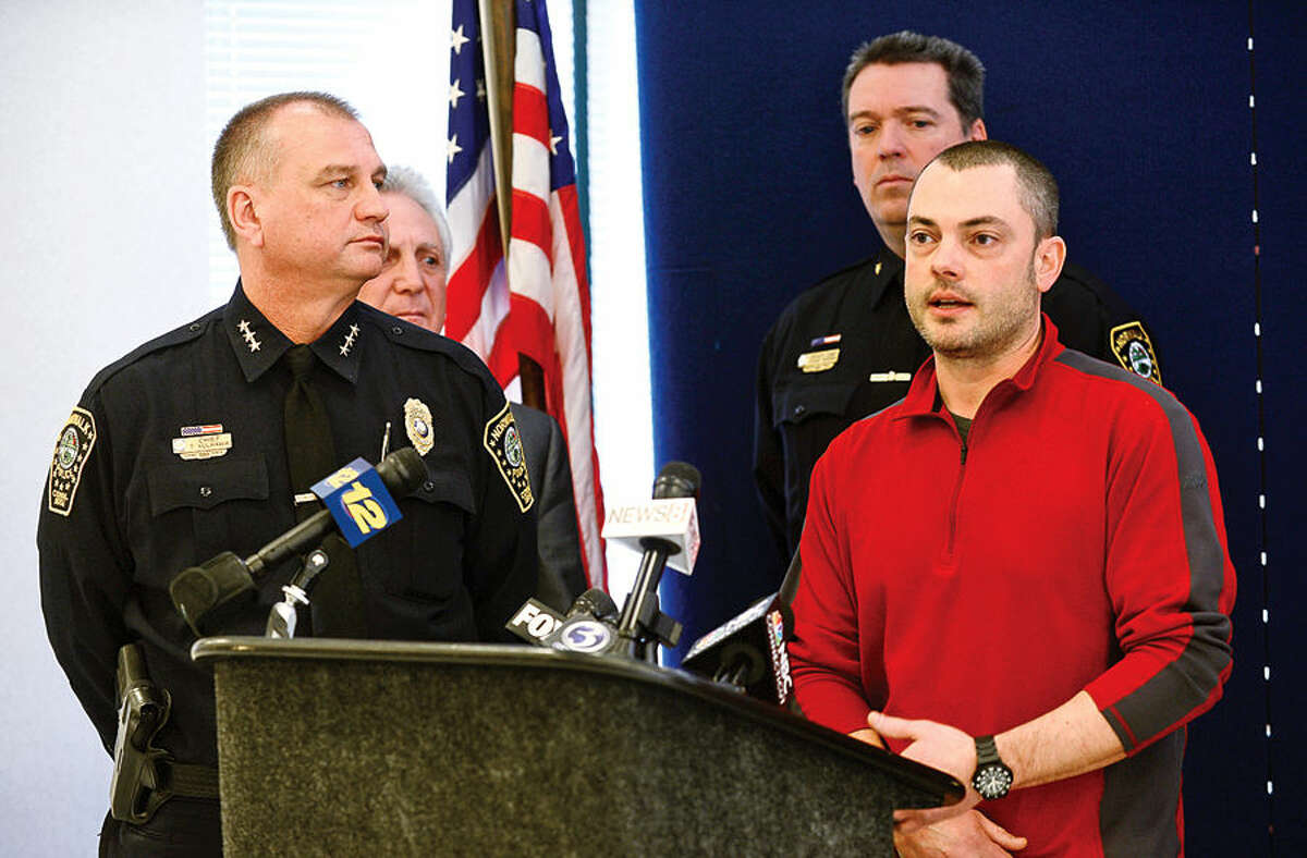 Hour photo / Erik Trautmann Norwalk police detective Dominic Cisero comments on the arrest of cabbie murder suspect Ramiro Arcos-Garcia during a press conference Friday with Police Chief Thomas Kulhawik, Norwalk Mayor Harry Rilling and Deputy Chief David Wrinn.