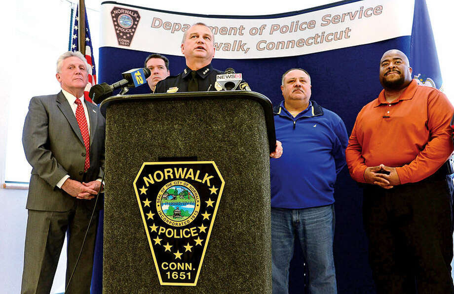Hour photo / Erik Trautmann Norwalk police chief Thomas Kulhawik annouce the capture of cabbie stabbing suspect Ramiro Arcos-Garcia during a press conference Friday with Norwalk Mayor Harry Rilling, Deputy Chief David Wrinn, and detectives Lt Thomas Mattera and Sergeant Lee Young.