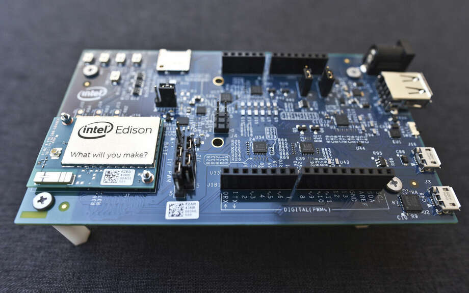 This Wednesday, Dec. 10, 2014 photo shows the Intel Edison, a small programmable computer the size of an SD memory card, seated on an electronics expansion board, in Decatur, Ga. The Edison has both Wi-Fi and Bluetooth technology built in, as well as a full distribution of the Linux operating system. (AP Photo/Ron Harris)