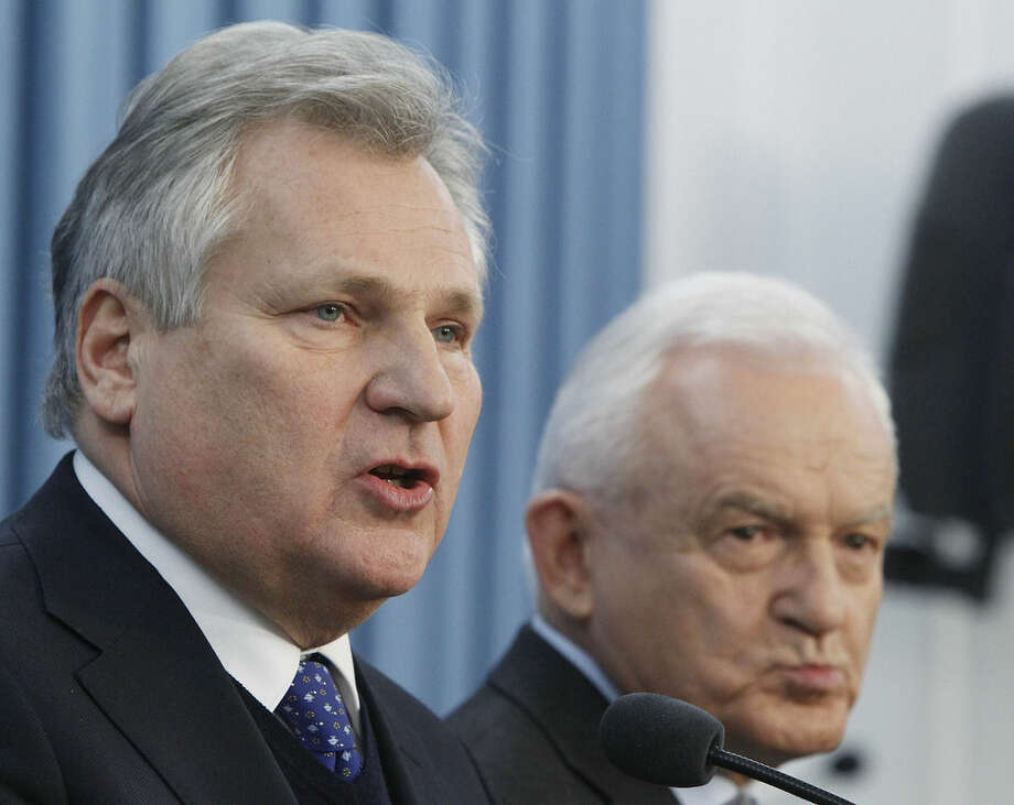 Former President Aleskander Kwasniewski,left, and former Prime Minister Leszek Miller, who were in power when the CIA ran a secret prison in Poland, speak to reporters a day after the publication of a report that sheds lights on the CIA program that involved the torture of detainees, in Warsaw, Poland, Wednesday, Dec.10, 2014. (AP Photo/Czarek Sokolowski)