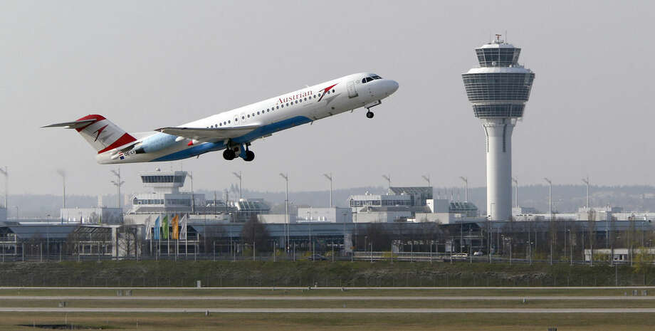 AP file photo/Matthias SchraderIn this April 1 file photo, a Austrian Airlines airplane takes off from the airport in Munich, southern Germany. Flying could get cheaper next year as airlines say they will finally start passing on some of the savings made on plummeting oil prices.