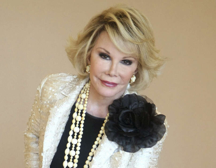 "FILE - This Oct. 5, 2009 file photo shows Joan Rivers during the 25th International Film and Programme Market for TV, Video, Cable and Satellite, in Cannes, southeastern France. According to Rivers' 2014 will, which was filed in New York State Surrogate's Court, the late comedienne made her daughter Melissa Rivers her will's executor with ""the broadest and most absolute permissible direction"" over a fortune that has been estimated as high as $150 million. Rivers died Sept. 4 at 81 of brain damage due to lack of oxygen. She'd stopped breathing during an endoscopy days earlier. (AP Photo/Lionel Cironneau, File)"