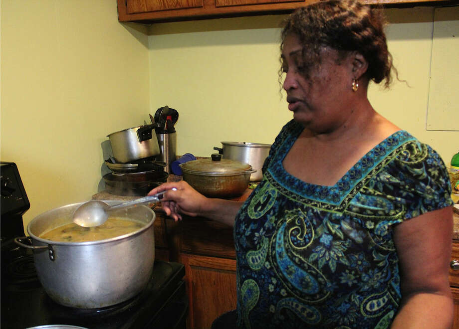 Hour photo/Miranda Zhang Marie Bourdeau, cooks Bouillon, a traditional Haitian soup of beef, yam and other vegetables on a November Saturday afternoon.