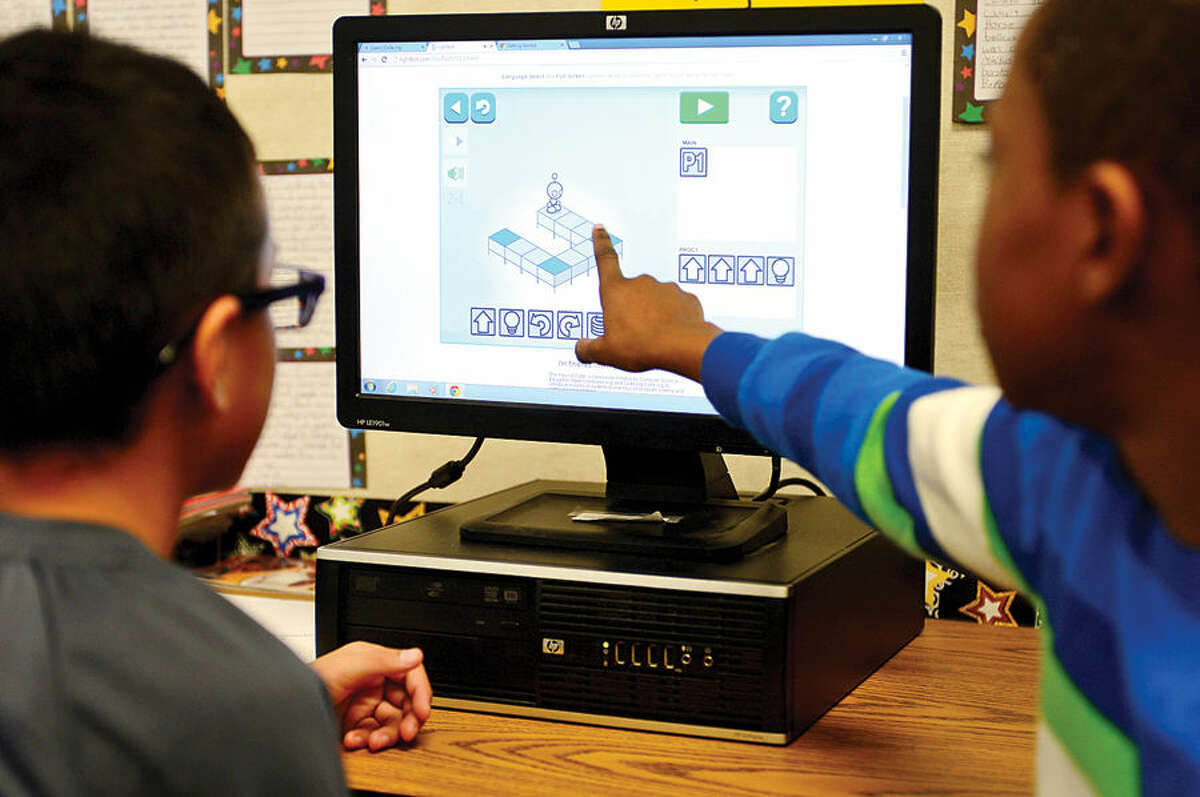 Hour photo / Erik Trautmann Kendall Elementary School students, including 4th graders Isaac Herrera and Ebel Alliance, join millions of students around the world for Hour of Code, a worldwide initiative to teach students coding and computer programming Thursday.