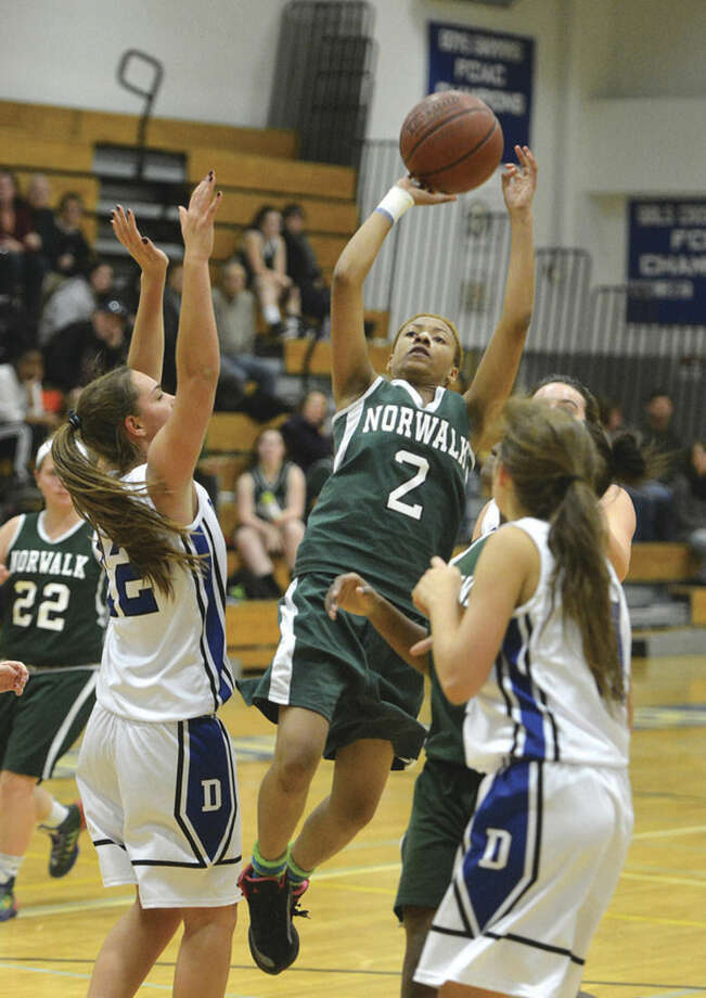 Hour photo/Alex von KleydorffNorwalk's Tamoriana Thomas shoots over a Darien defender during Friday night's game.