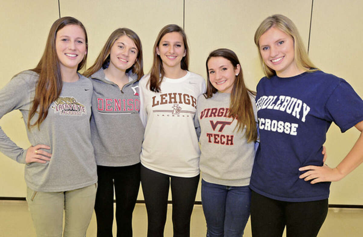Hour photo/Erik Trautmann Staples High School lacrosse players, from left to right, Amelia Haisler, Nicki Najarian, Samantha Kratky, Paige Murray and Jenna McNicholas signed their national letters of intent to play collge lacrosse Friday.